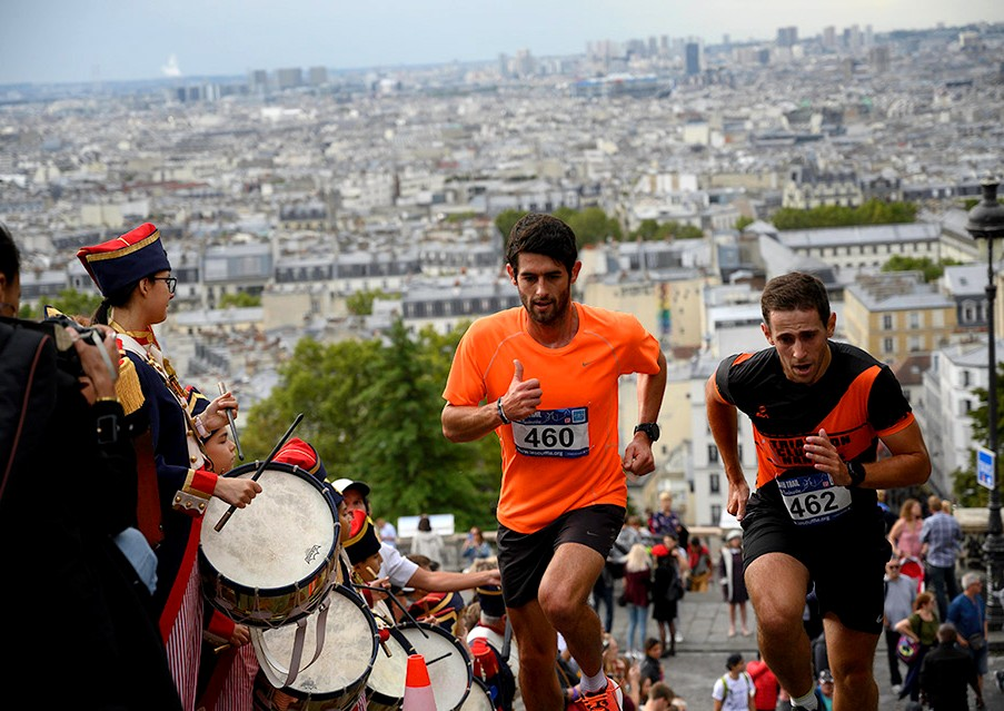 The accompaniment of the little drums of Montmartre and the view of Paris in the background